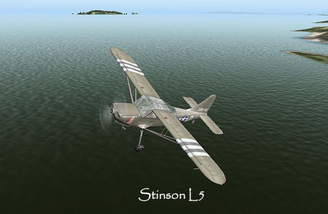 Stinson L5 over Coast
